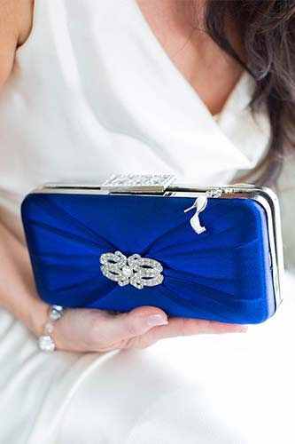 Hedy clutch dyed cobalt with Deco brooch