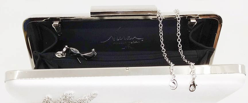 Juliet clutch interior with detachable chain handle and Starletta charm zipper pull