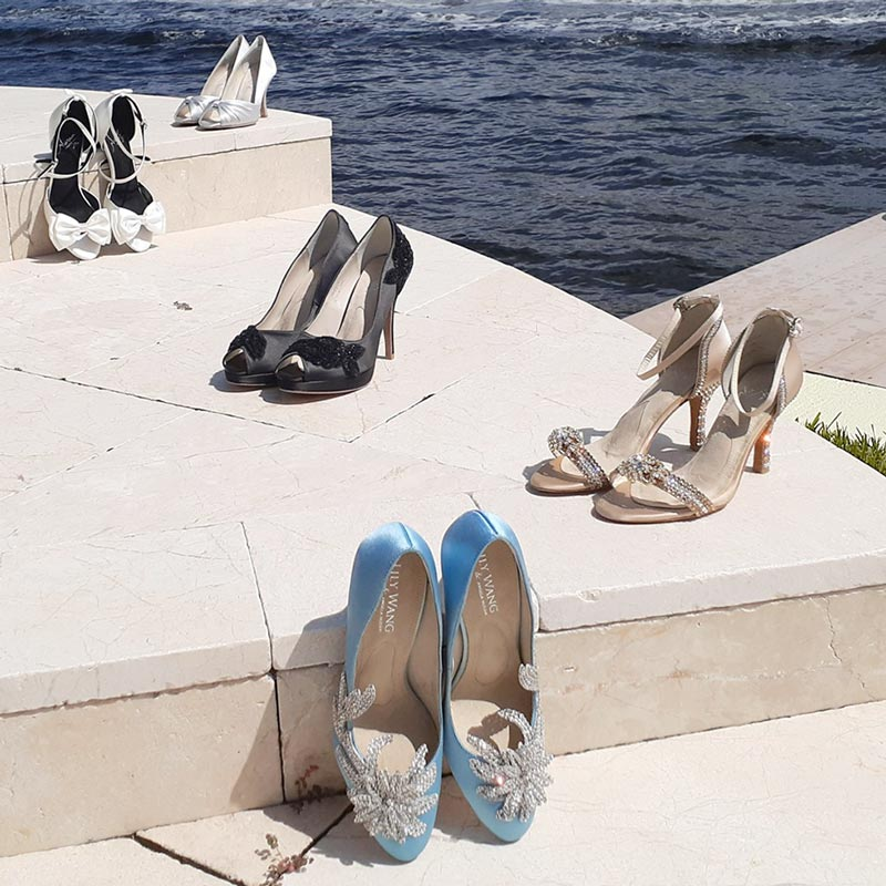 Angela Nuran Shoes on stairs with ocean background
